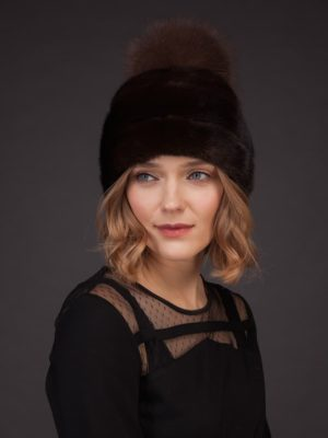 Dark brown mink fur hat with leather inserts and fox fur pom pom
