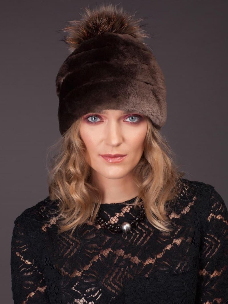 Natural sheared brown beaver fur hat with fox pom-pom