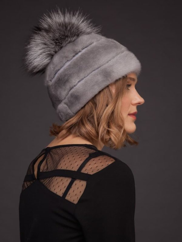 Natural sapphire mink fur hat with leather inserts and fox fur pom pom