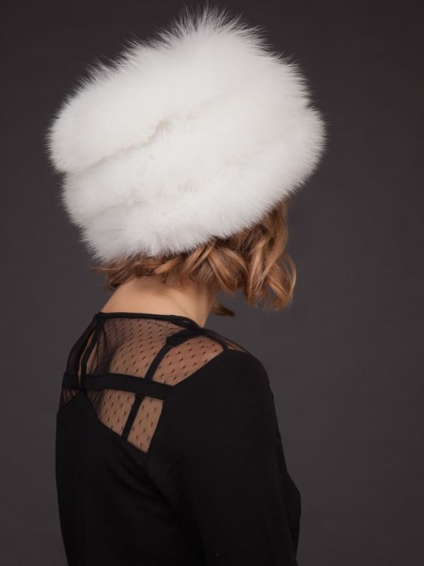 White fox fur hat with leather inserts and flat top