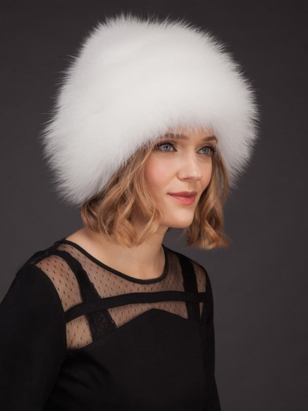 White fox fur hat with leather inserts and pom-pom