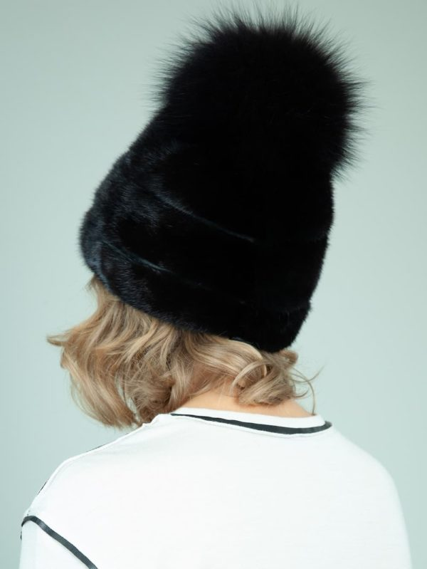 black mink fur hat with leather inserts and big fox pom pom for women