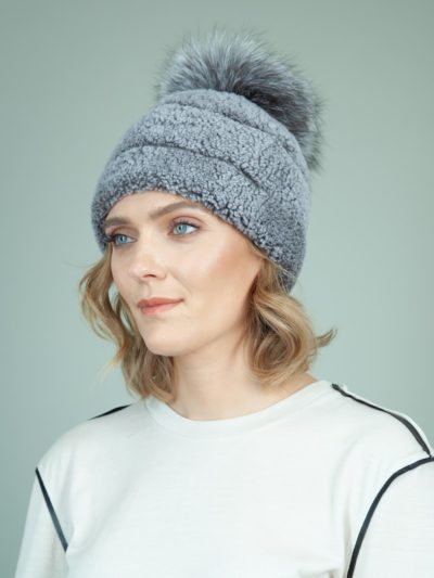 blue sheepskin fur hat with fox pom pom for women