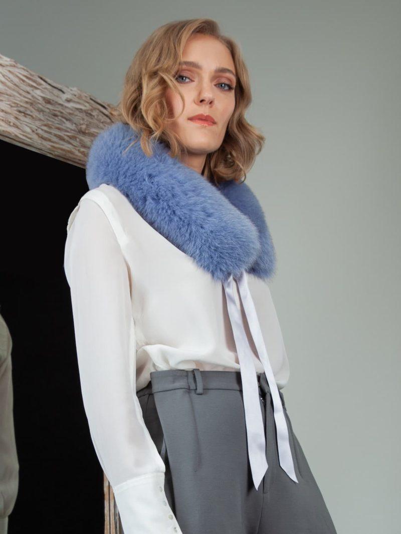 tied bright blue fox fur scarf