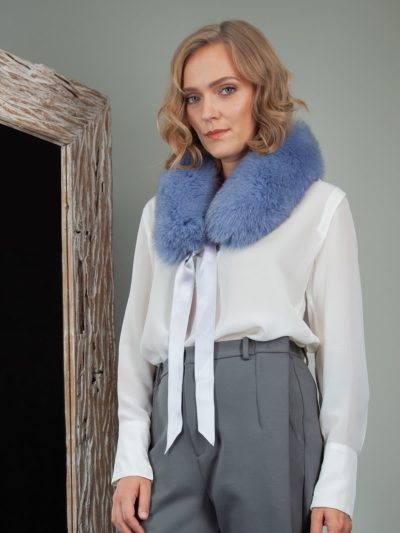 tied bright blue fox fur scarf