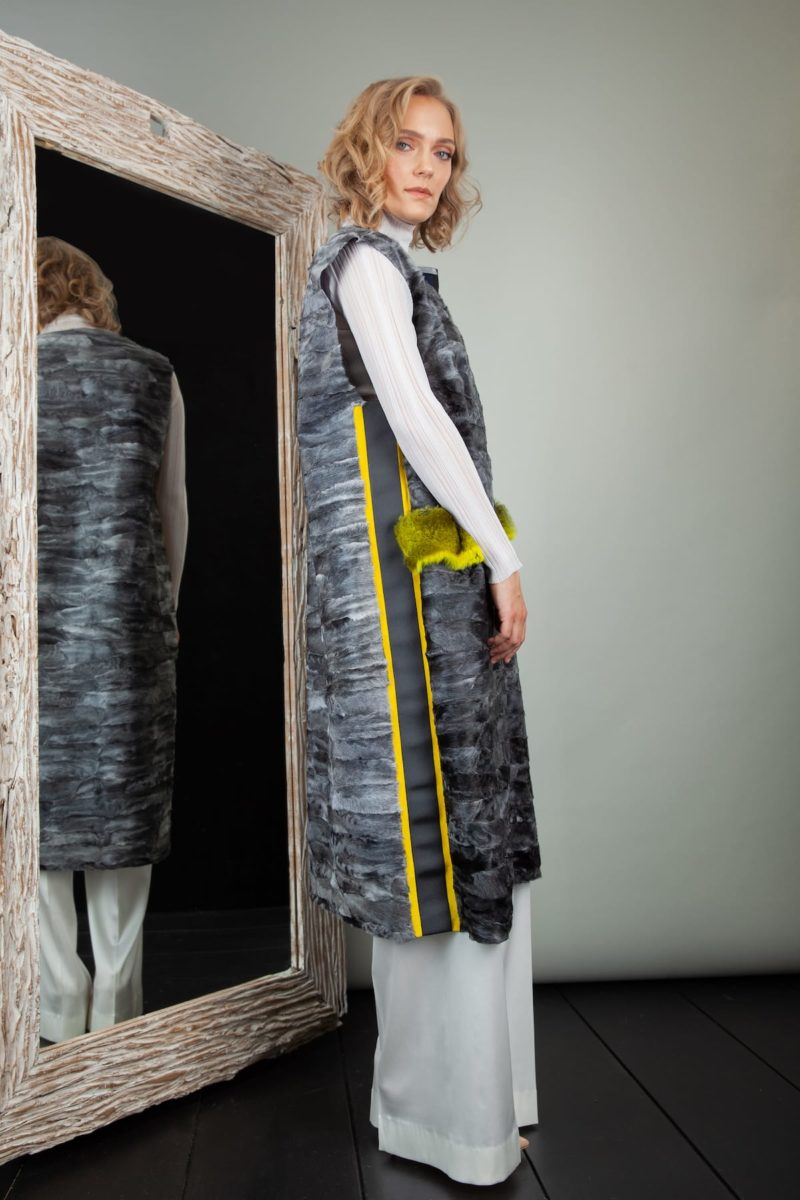 gray astrakhan karakul fur vest with yellow chinchilla pocket decoration