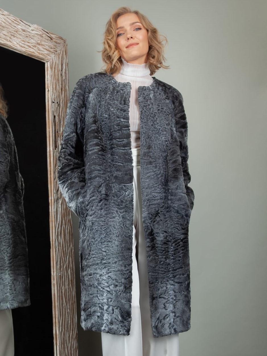 medium-length gray astrakhan karakul fur coat with detachable fox collar