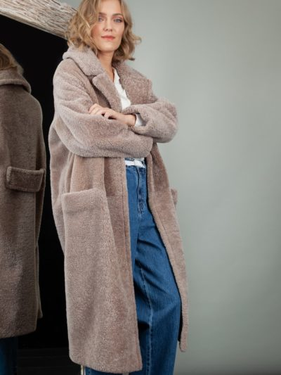 oversized beige sheepskin teddy coat with revere collar for women