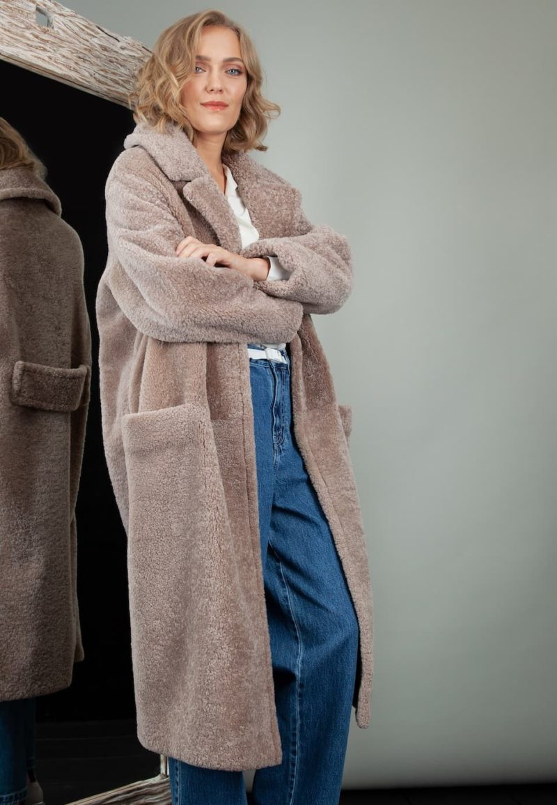 oversized beige sheepskin teddy coat with revere collar for women
