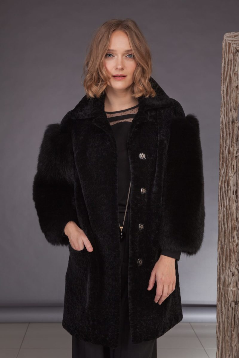black mouton jacket with fox fur sleeves