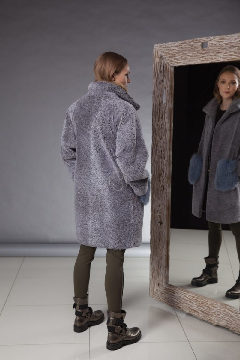 blue shearling coat with fox fur pockets