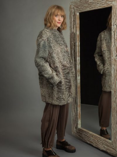 medium-length gray astrakhan karakul coat