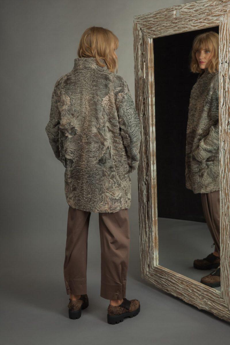 medium-length gray astrakhan karakul coat