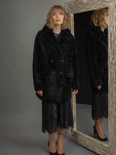 medium-length black sheepskin fur coat