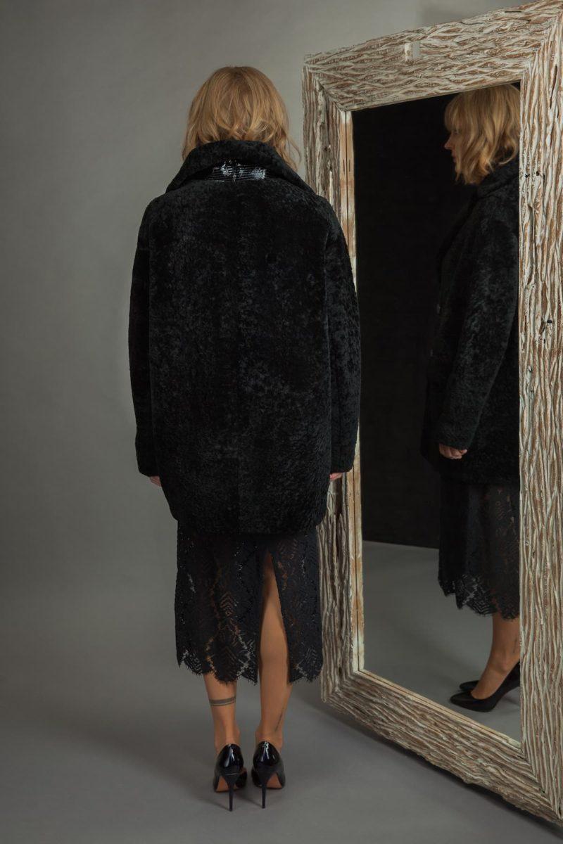 medium-length black sheepskin fur coat