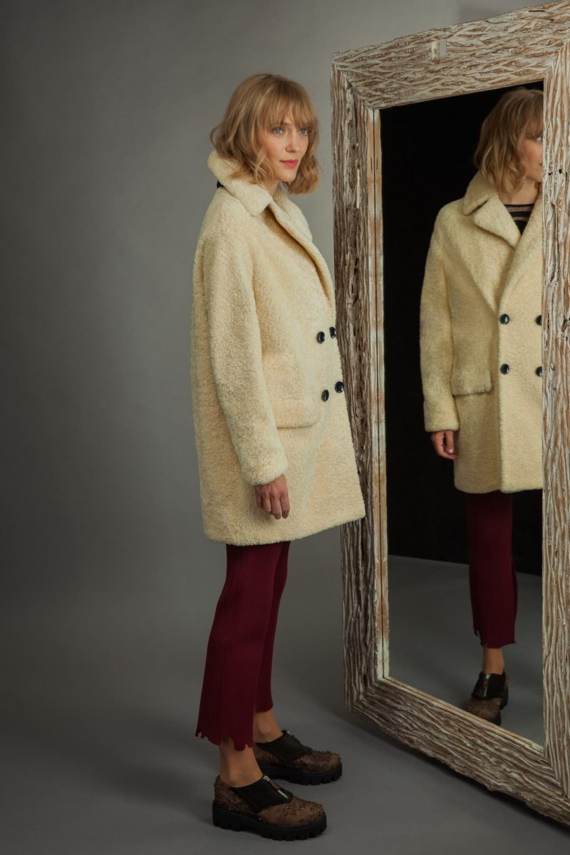 medium-length yellow sheepskin fur coat with revere collar