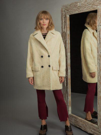 medium-length yellow sheepskin fur coat with revere collar