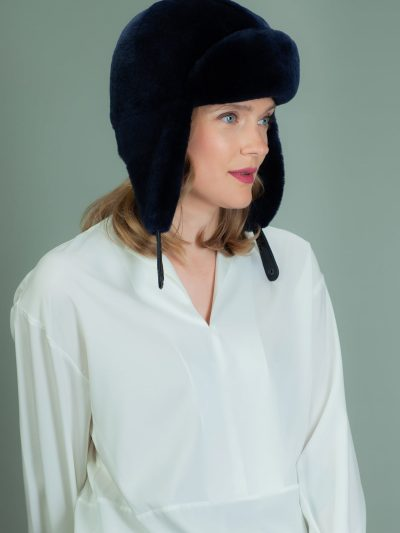 dark blue mouton sheepskin trapper hat with ear flaps
