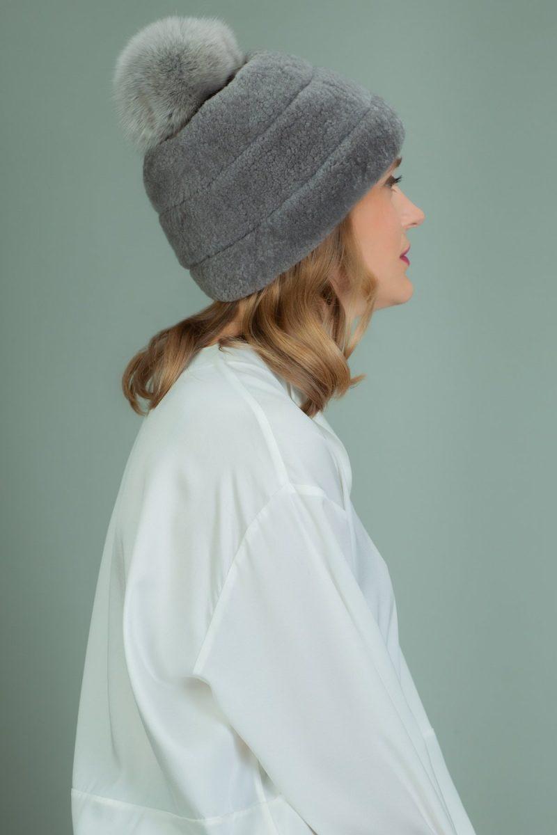 gray sheepskin hat with fox fur pom-pom