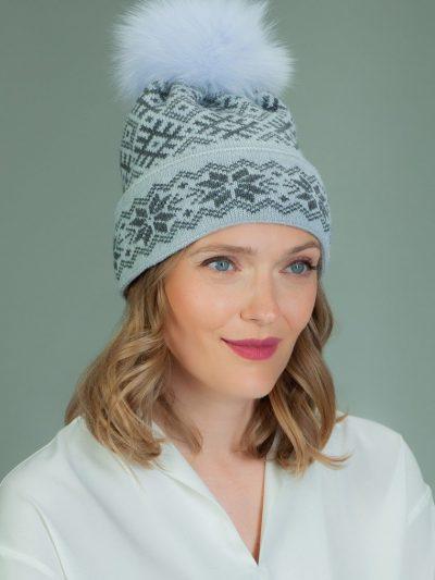 knit wool hat with fur pom-pom in gray star pattern