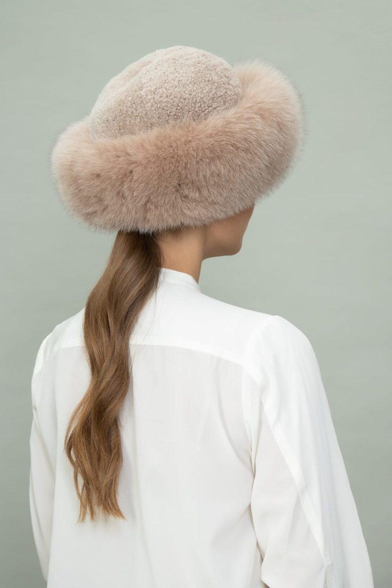 brown fox fur and beige sheepskin hat