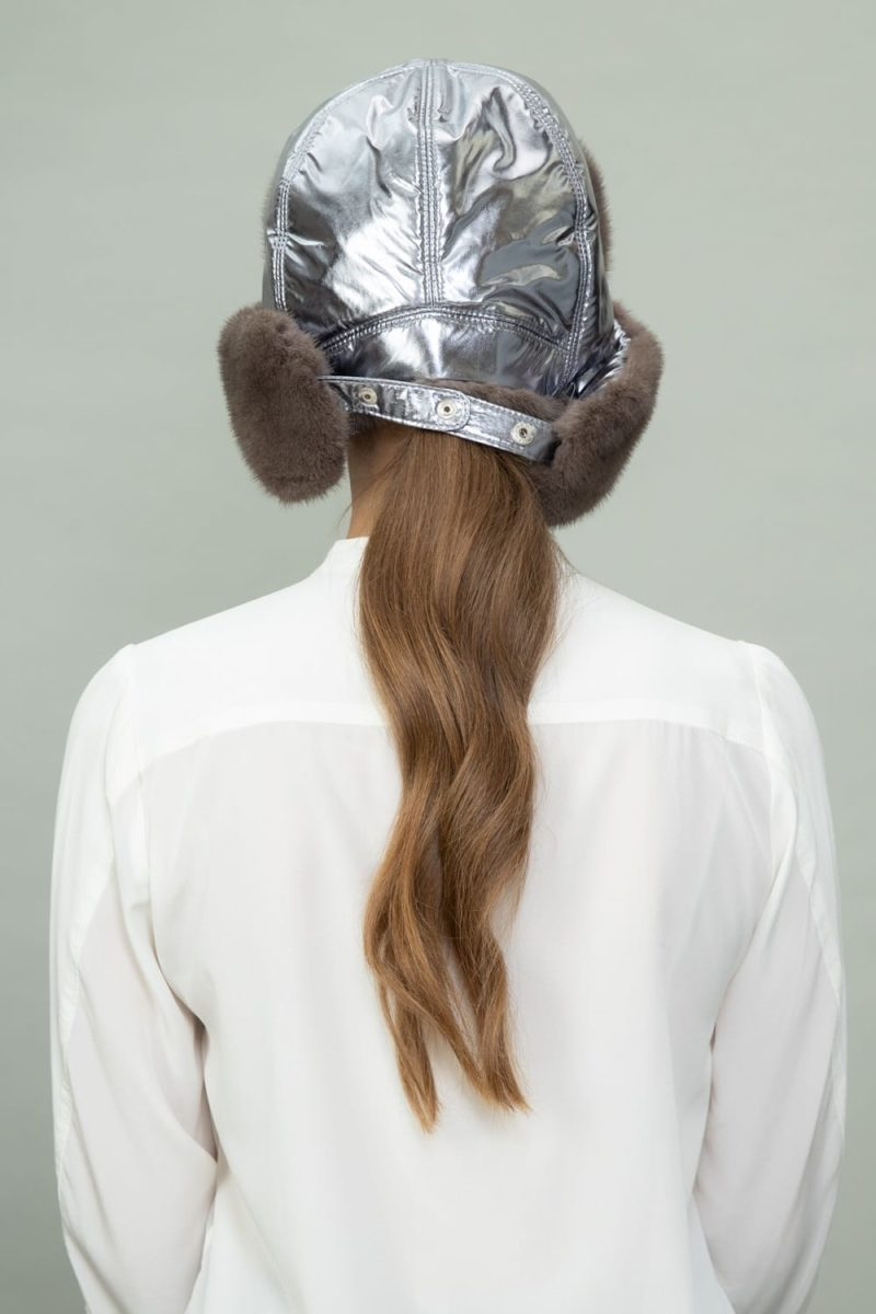 brown mink fur and silver puffy hat with ear flaps