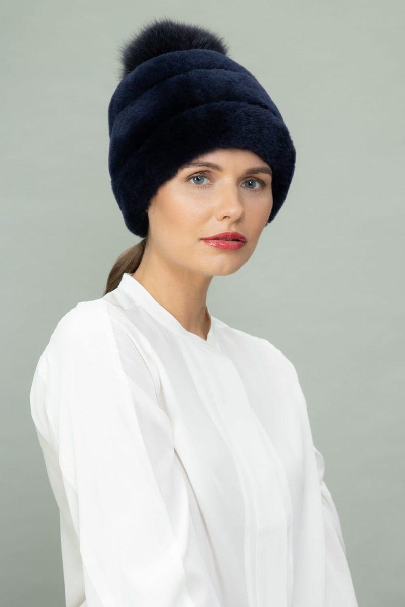 dark blue mouton fur hat with fox fur pom-pom