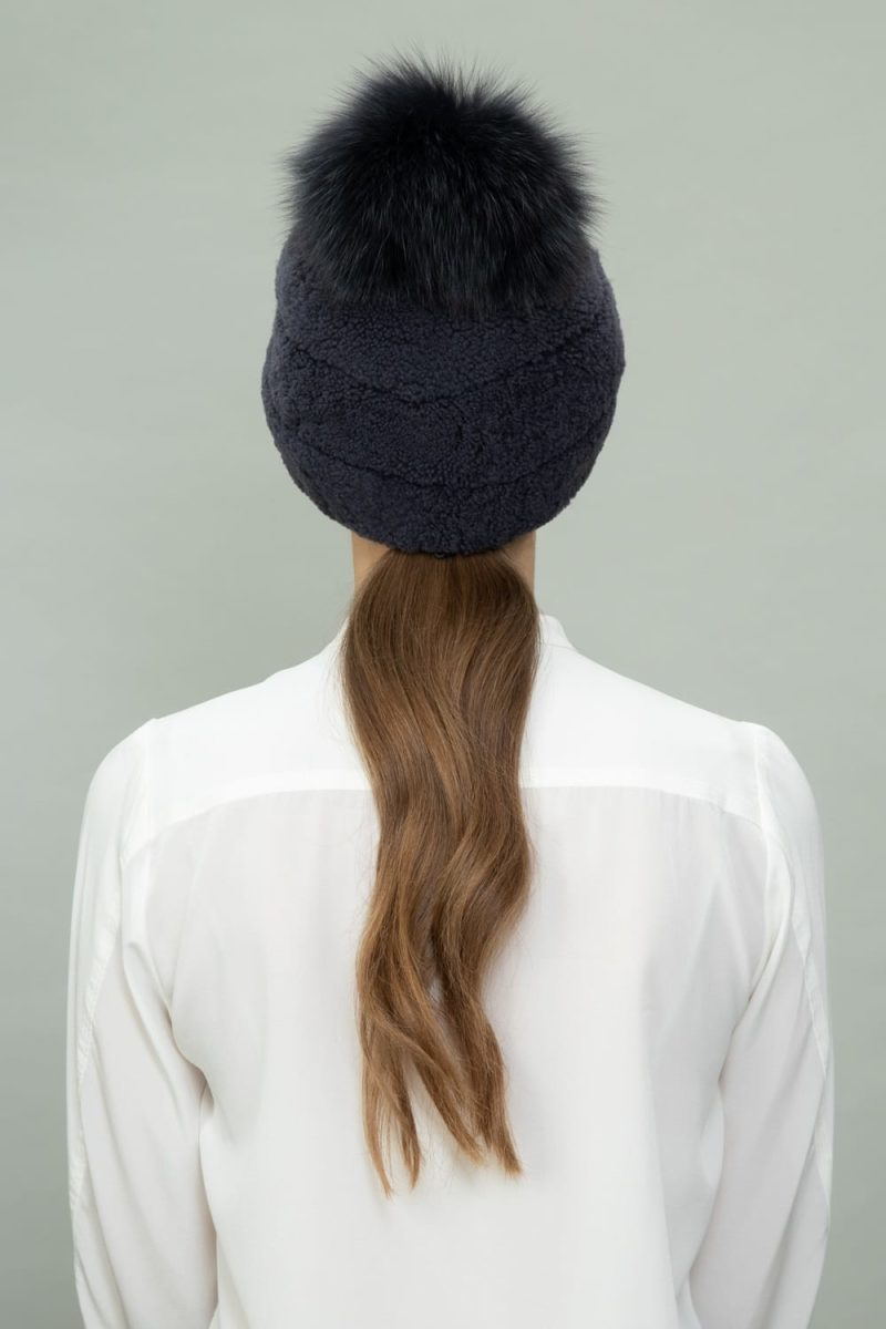 dark purple shearling fur hat with fox fur pom-pom