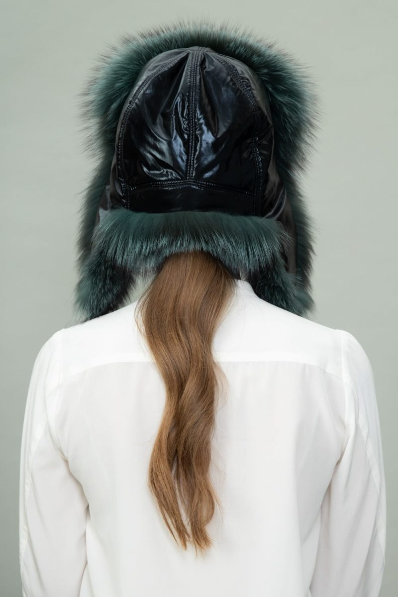 green fox fur and puffy hat with ear flaps