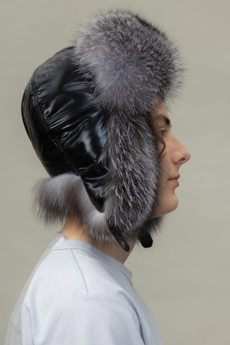 silver fox fur and black puffy padding hat with ear flaps