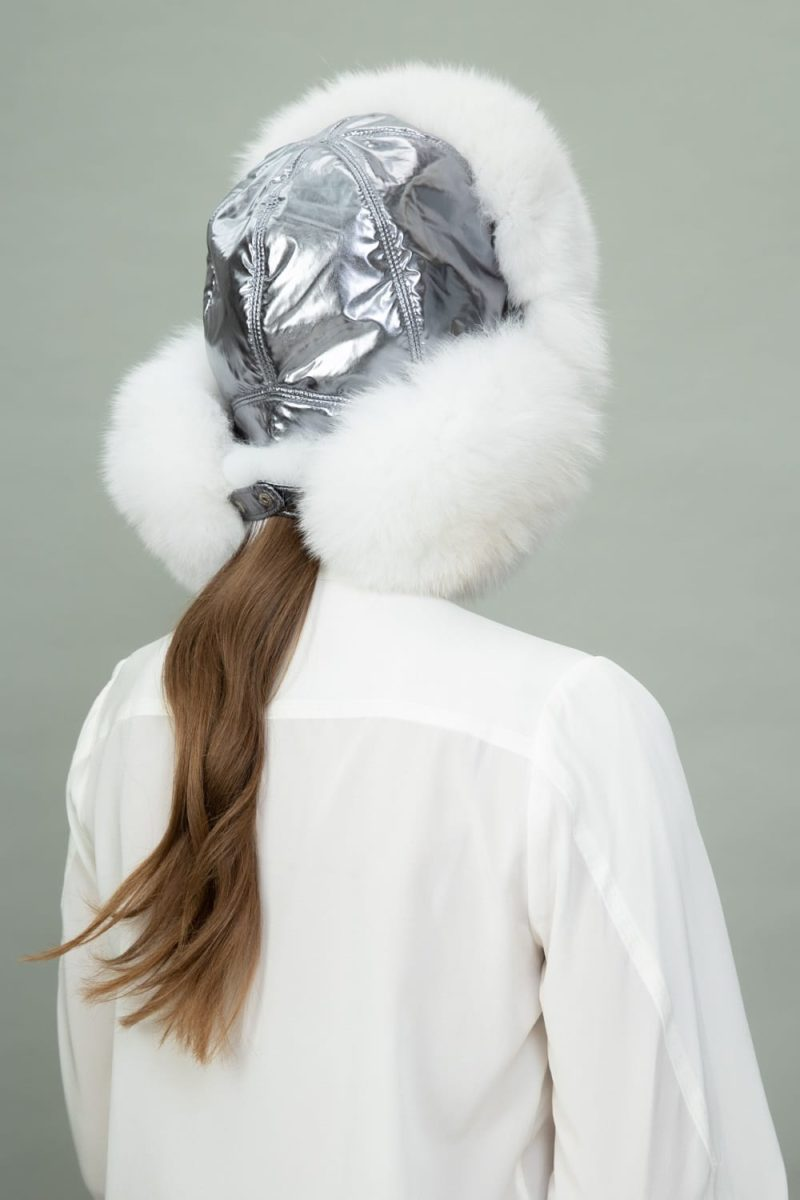 white fox fur and silver puffy hat with ear flaps